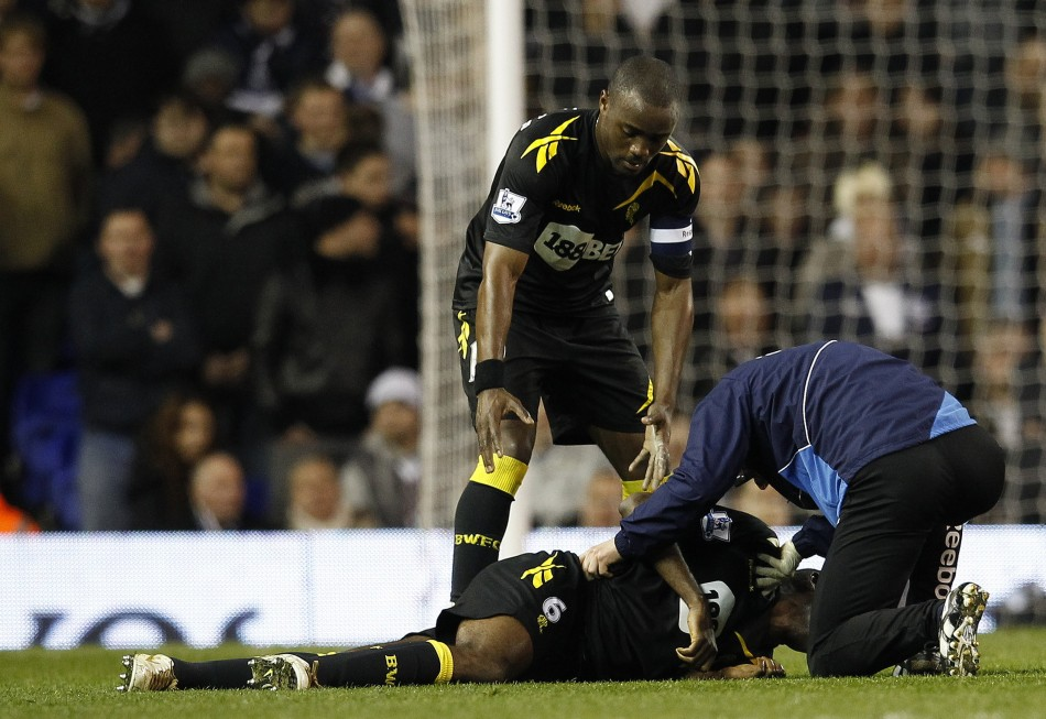 Bolton Wanderers Nigel Reo Coker helps a member of the club039s medical staff attend to Fabrice Muamba after he collapsed on the pitch during their FA Cup quarter-final soccer match against Tottenham Hotspur at White Hart Lane in London