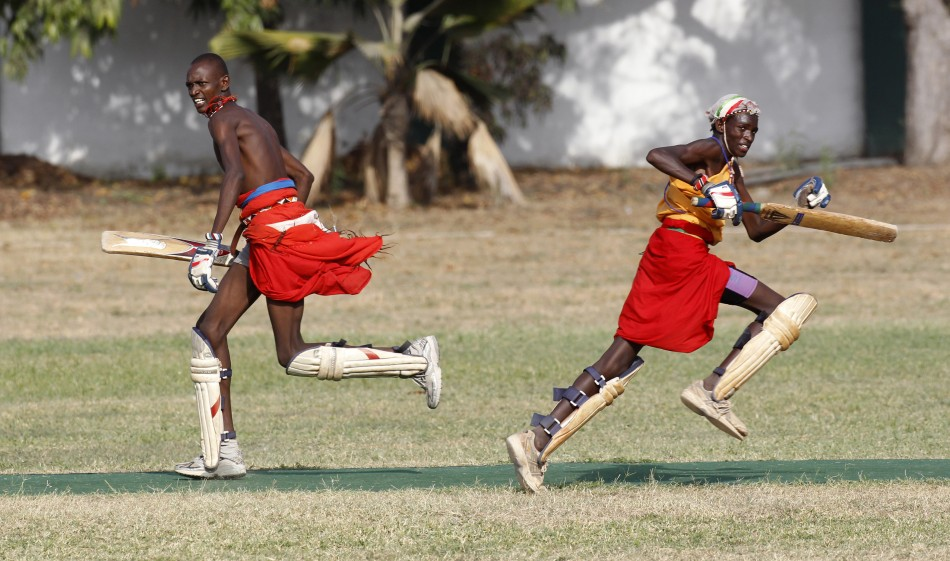 Players from the Maasai Cricket Warriors run between the wicket during their friendly match in Mombasa