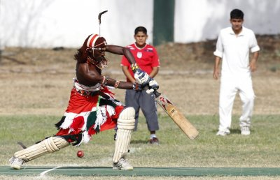Jonathan Ole Meshami of the Maasai Cricket Warriors plays a shot during their friendly match in Mombasa