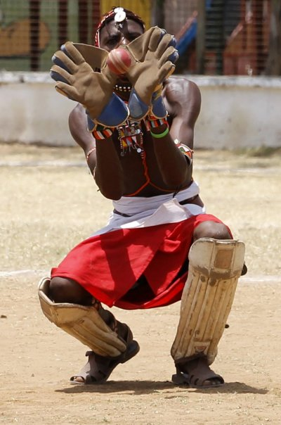A member of the Maasai Cricket Warriors team catches the ball during their friendly match in Mombasa
