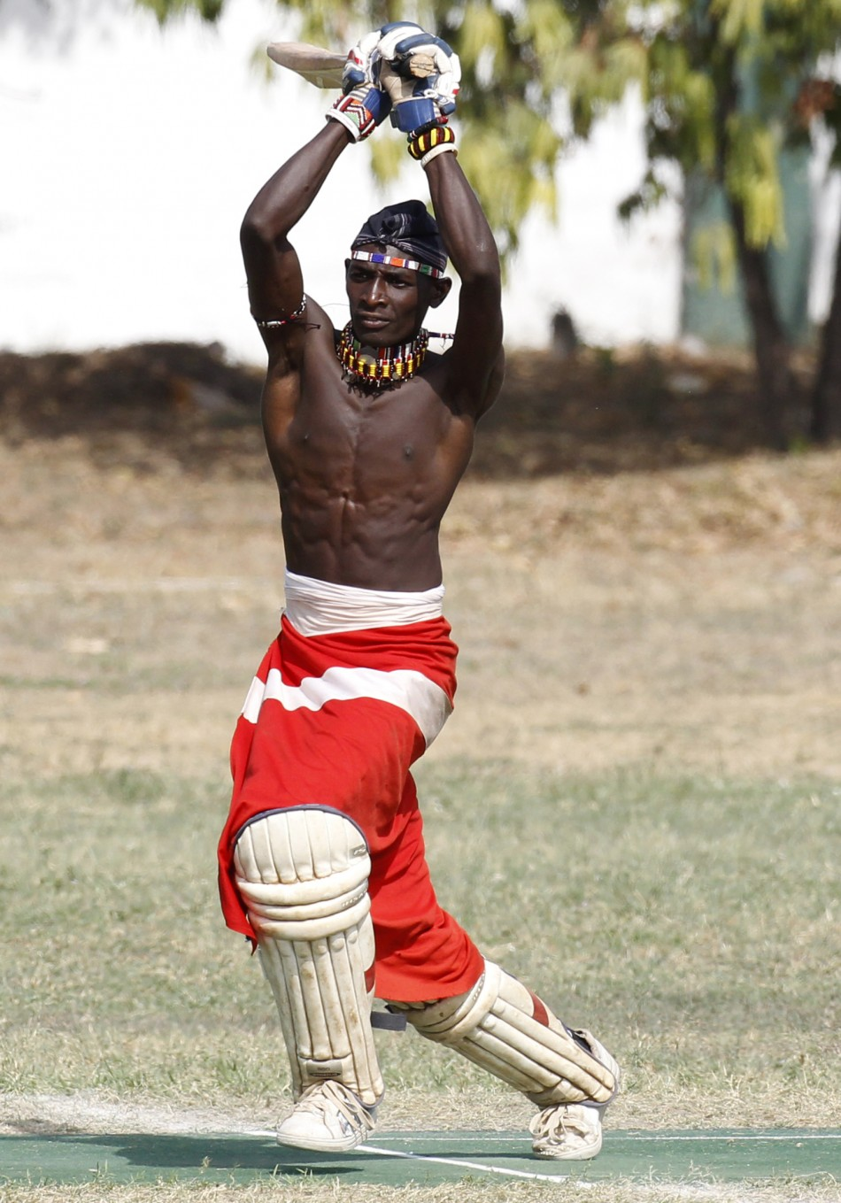 Olengais, captain of the Maasai Cricket Warriors, plays a shot during their friendly match in Mombasa