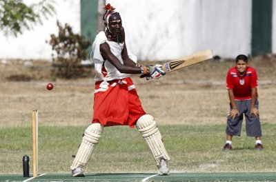 Njayo Takare of the Maasai Cricket Warriors plays a shot against the Jafferys team during their friendly match in the Kenyan coastal city of Mombasa