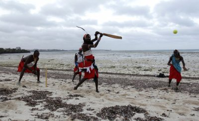 Members of the Maasai Cricket Warriors attend a practice session at the shores of the Indian Ocean in the Kenyan coastal city of Mombasa