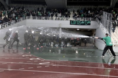 A soccer fan sprays water
