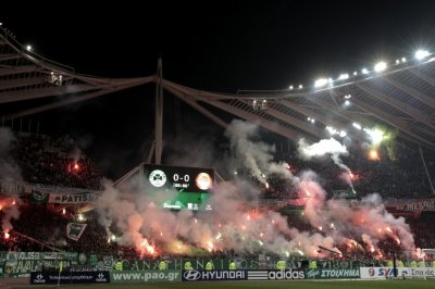 Panathinaikos fans hold flares