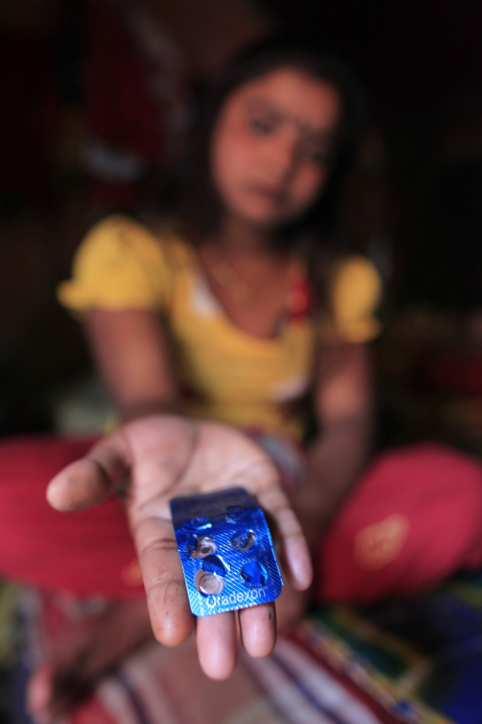 Seventeen-year-old prostitute Hashi shows Oradexon, a steroid, at Kandapara brothel in Tangail, a northeastern city of Bangladesh