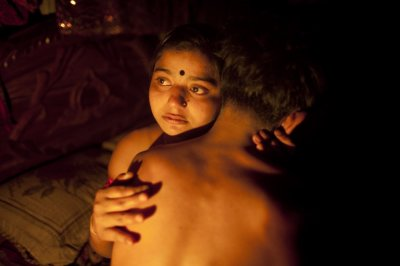 Seventeen-year-old prostitute Hashi, embraces a Babu, her quothusbandquot, inside her small room at Kandapara brothel in Tangail, a northeastern city of Bangladesh