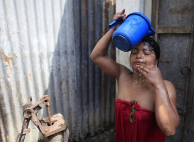 Seventeen-year-old prostitute Hashi washes her hair at Kandapara brothel in Tangail, a northeastern city of Bangladesh