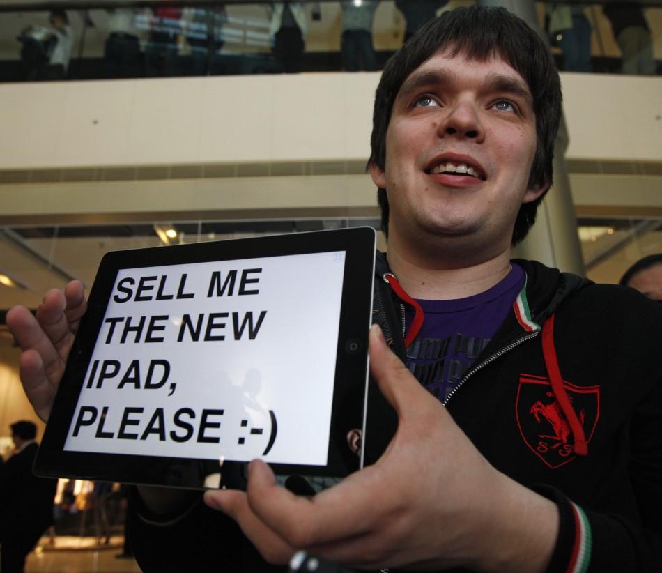 Omarov holds up his iPad at an Apple store in Hong Kong