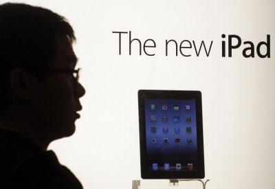 A man lines up to collect his pre-ordered new iPad outside an Apple store in Hong Kong