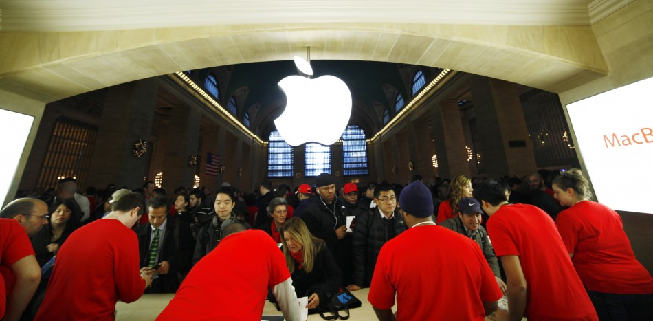 Customers buy Apple products inside the newest Apple Store during its opening on the East Balcony in the main lobby of New York Citys Grand Central Station