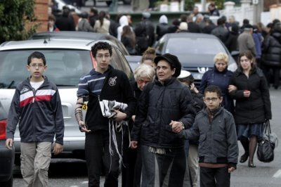 Relatives leave the Ozar Hatorah Jewish school in Toulouse, southwestern France