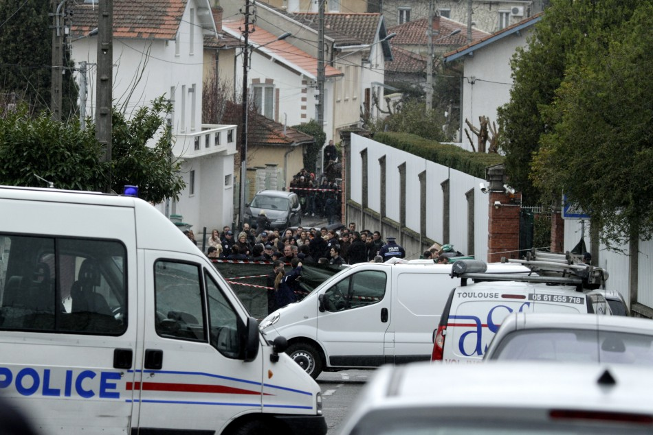 French police conduct their investigation outside the Ozar Hatorah Jewish school in Toulouse, southwestern France