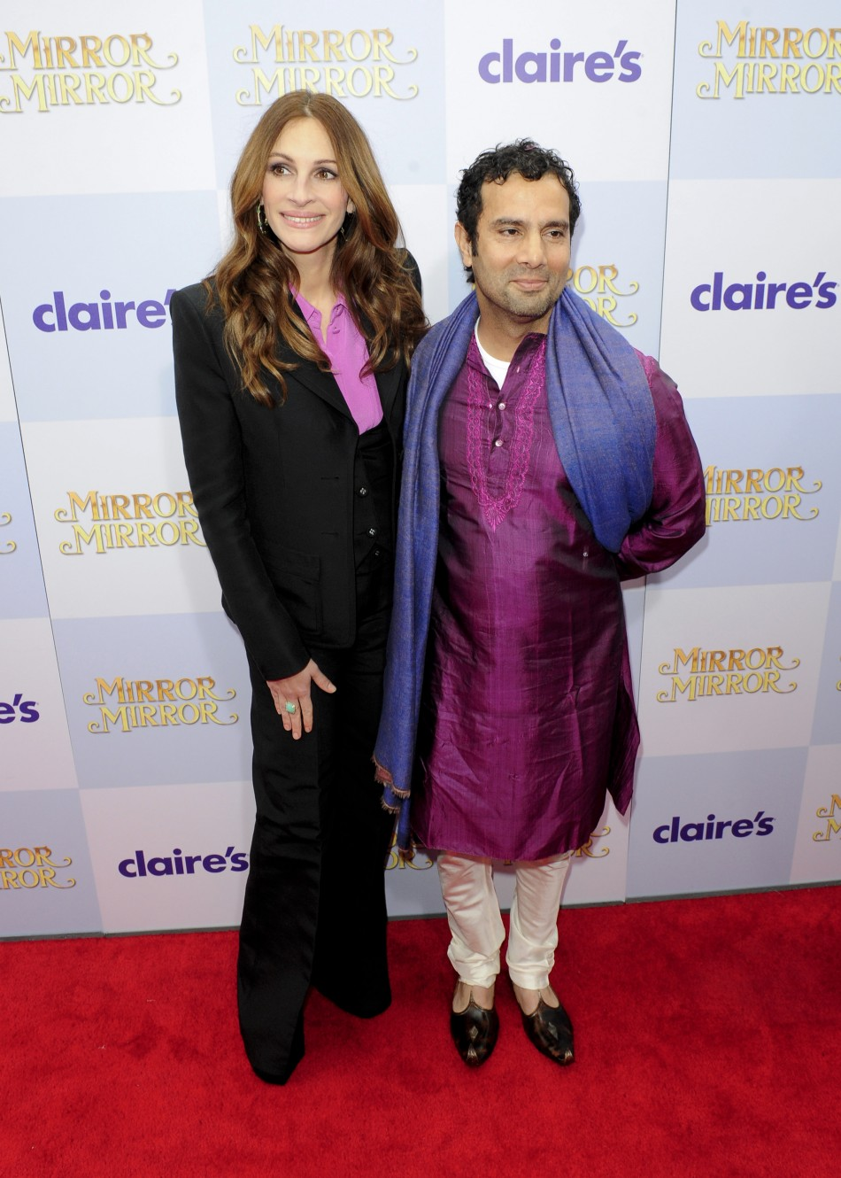 "Actress Julia Roberts and director Tarsem Singh arrive at the Hollywood world premiere of ""Mirror Mirror"" in Los Angeles"