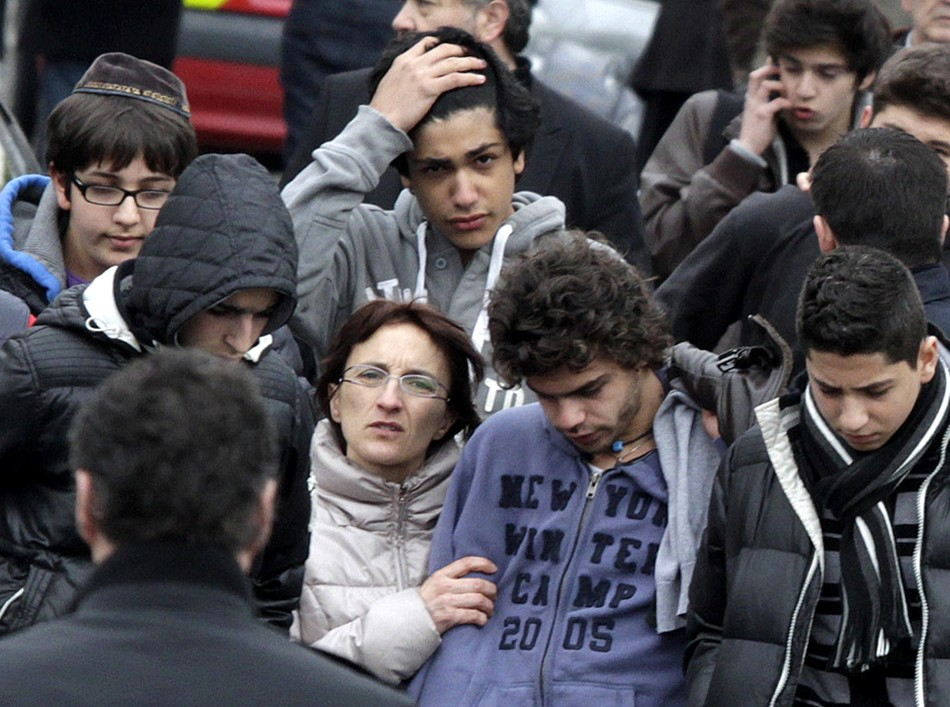 Relatives and school children leave the Ozar Hatorah Jewish school in Toulouse, southwestern France