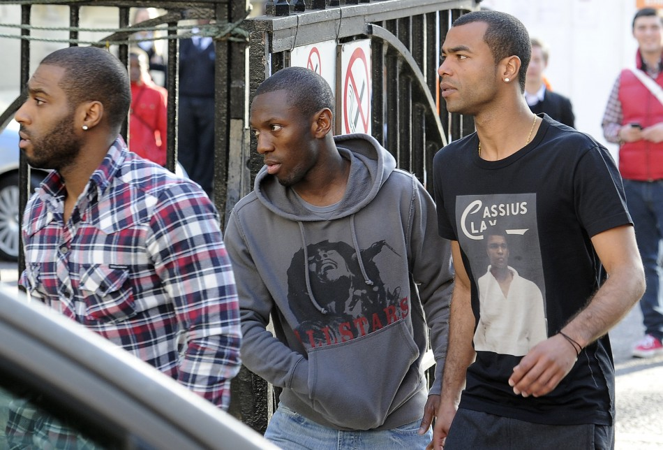 Ashley Cole (R) and Shaun Wright Phillips (C) arrive at the London Chest Hospital in east London