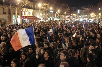 People hold French flags