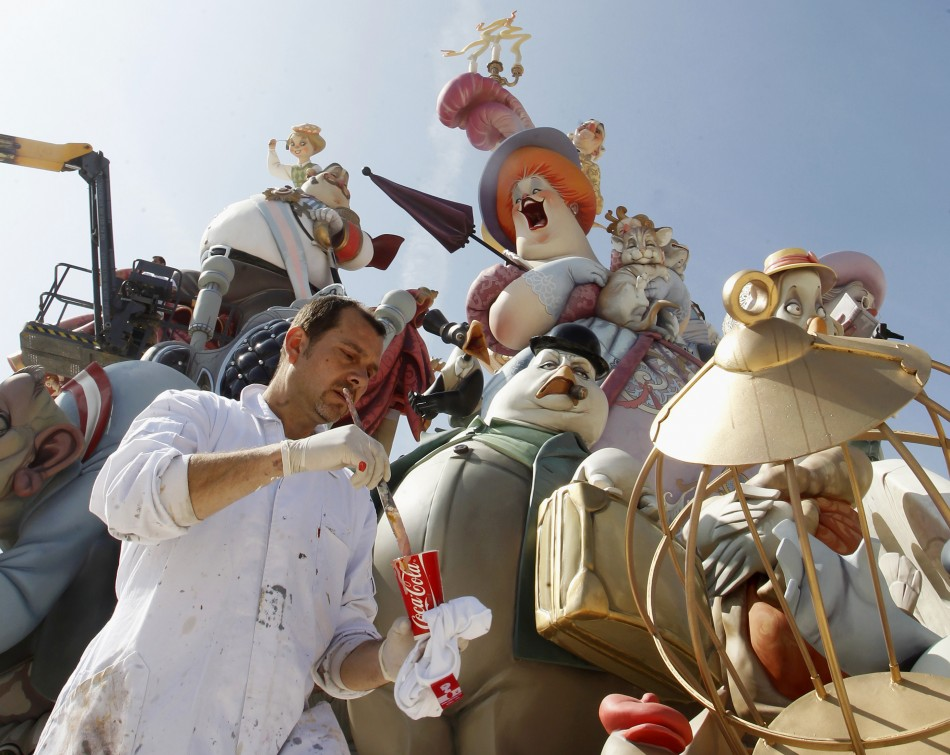 "A craftsman puts finishing touches on a giant figure ahead of the ""Fallas"" festival in Valencia"