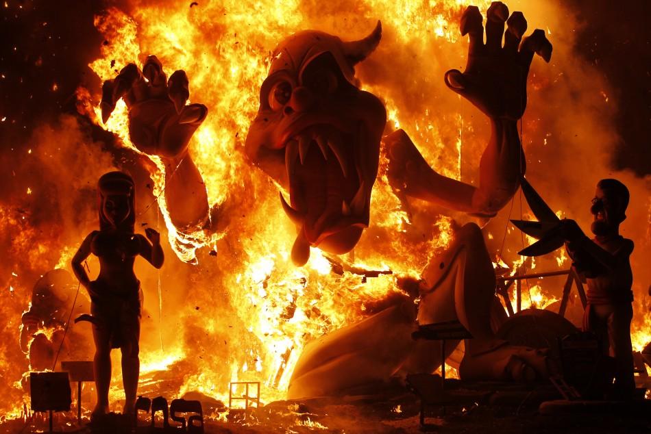 Effigies burn during the finale of the Fallas festival in Valencia