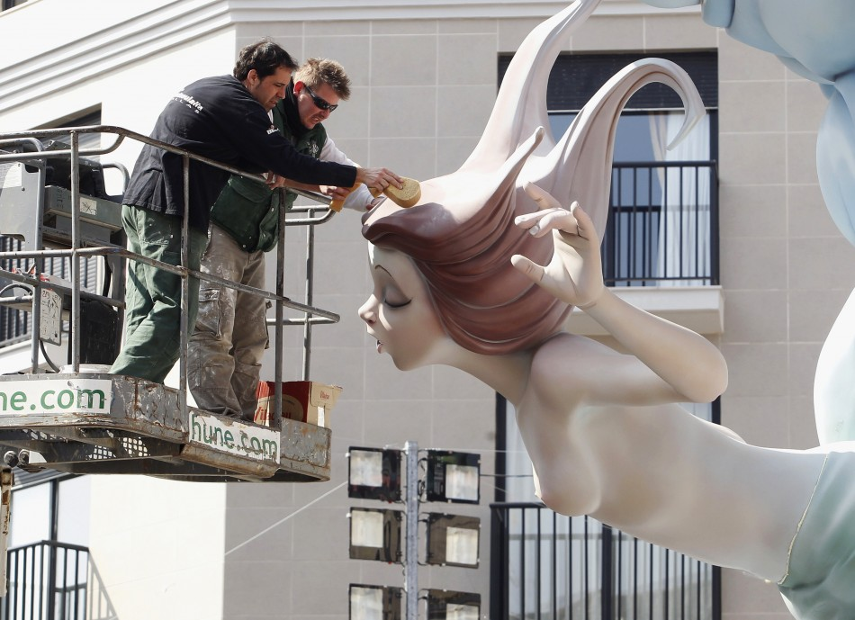 Craftsmen puts finishing touches on a giant figure ahead of the quotFallasquot festival in Valencia