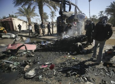 Residents gather at site of bomb attack in Kerbala