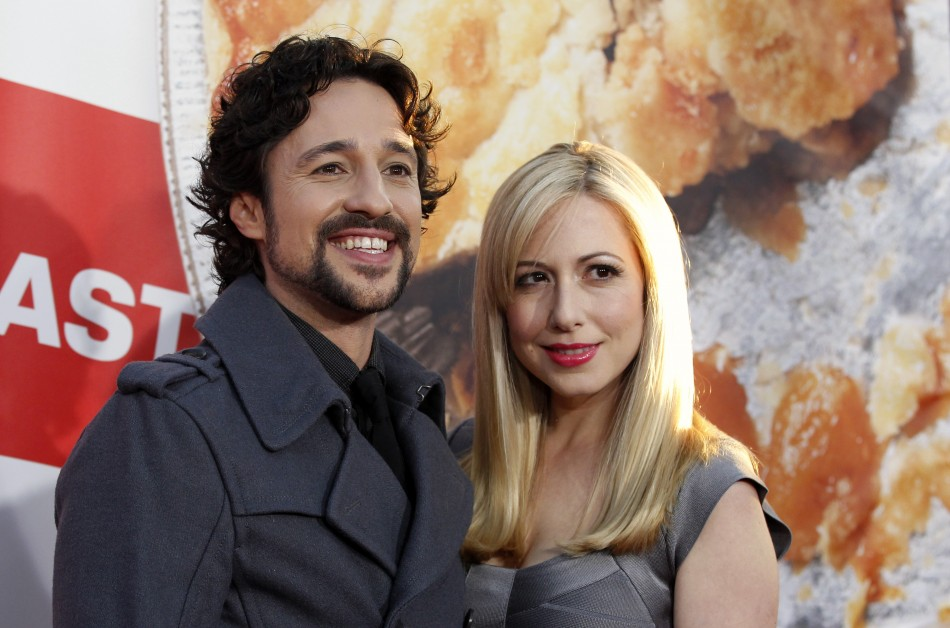 Cast member Nicholas and his Colette pose at the premiere of quotAmerican Reunionquot at the Graumans Chinese theatre in Hollywood