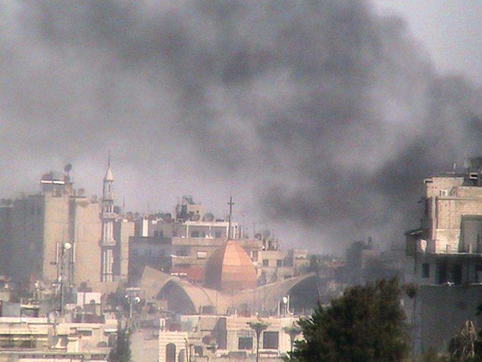 Smoke rises from Bab Sabaa neighbourhood of Homs