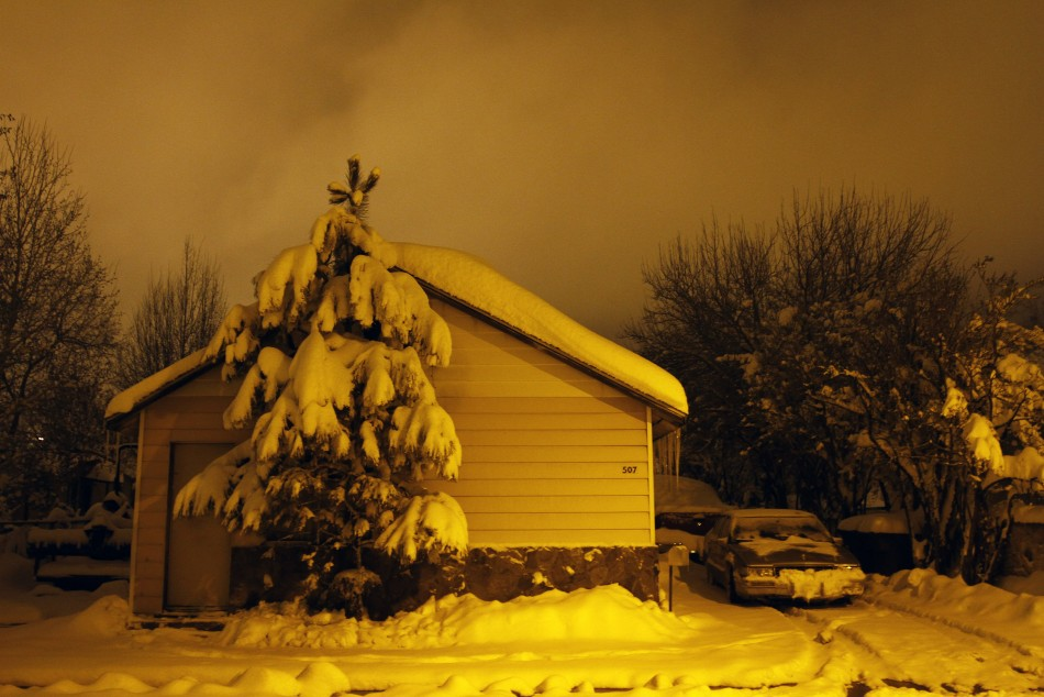 Several inches of snow cover a house and its surroundings in Flagstaff