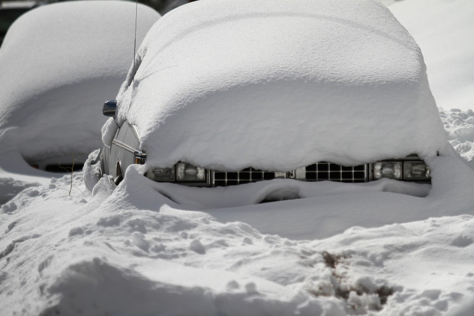 Snow blankets two cars after a winter storm in Flagstaff