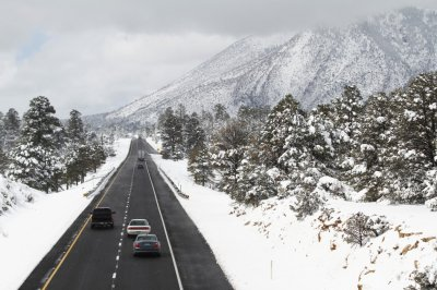 Motorists travel westbound along Interstate 40 after several inches of snow fell during a winter storm in Flagstaff, Arizona