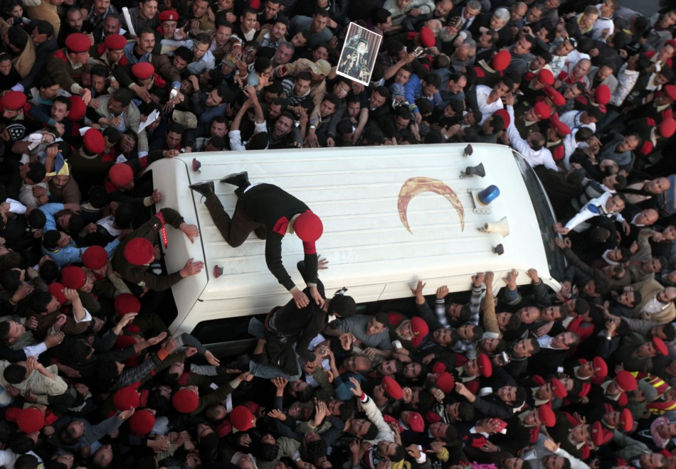 Military police restrain mourners for funeral of Pope Shenouda III