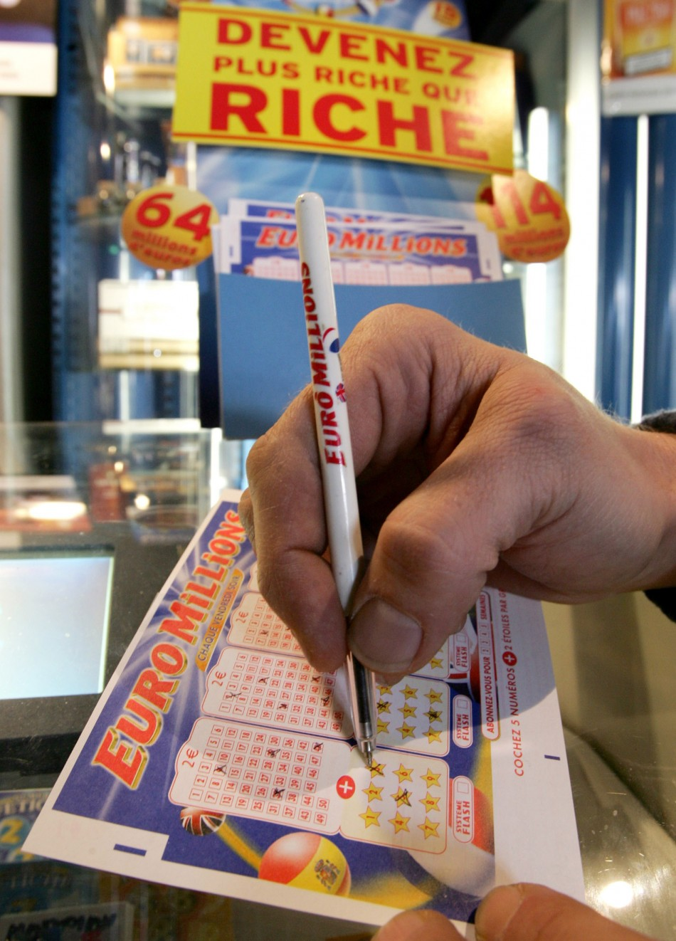 "Customer selects numbers on ""EuroMillions"" lottery ticket in Truchtersheim on eve of draw"