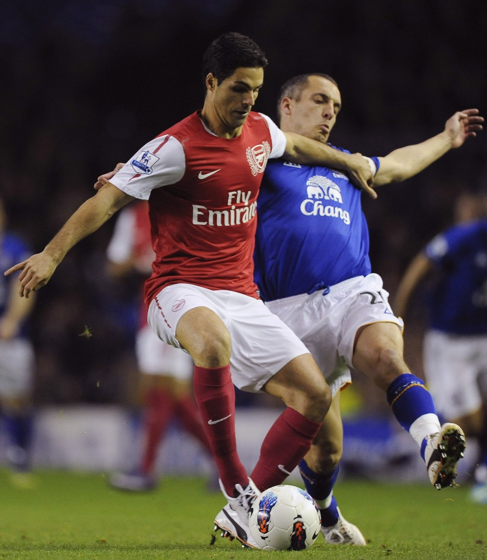 Everton's Osman challenges Arsenal's Arteta during their English Premier League soccer match in Liverpool