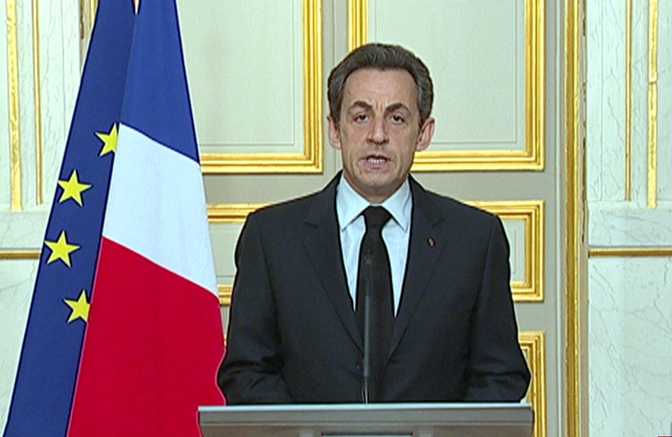 France's President Sarkozy seen making a statement on French national television from the Elysee Palace in Paris in a still image taken from video