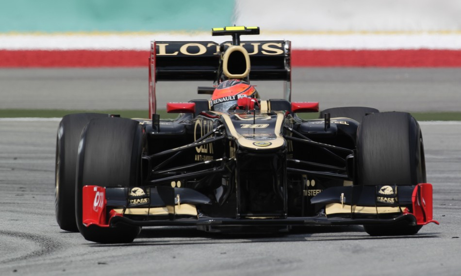 Lotus F1 Formula One driver Raikkonen drives during the first practice session of the Malaysian F1 Grand Prix at Sepang International Circuit outside Kuala Lumpur