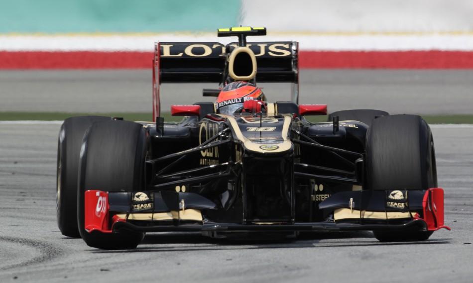 Lotus F1 Formula One driver Raikkonen drives during the first practice session of the Malaysian F1 Grand Prix at Sepang International Circuit outside Kuala Lumpur