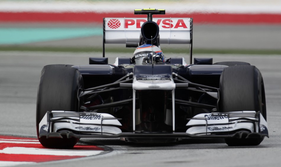 Williams Formula One driver Senna drives during the first practice session of the Malaysian F1 Grand Prix at Sepang International Circuit outside Kuala Lumpur