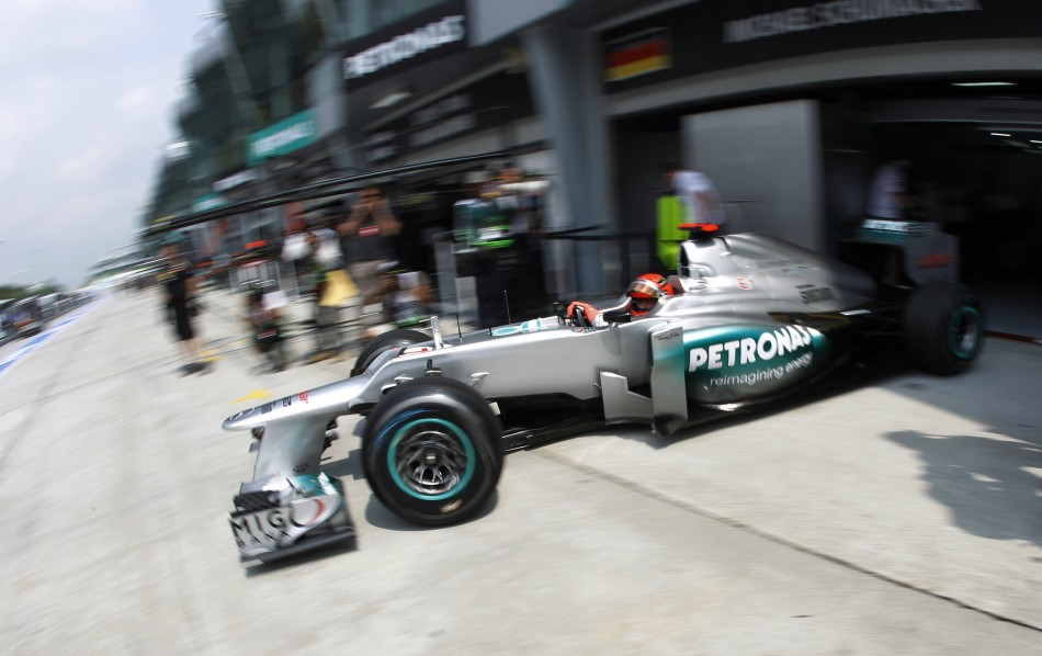 Mercedes Formula One driver Schumacher leaves his teams garage during the first practice session of the Malaysian F1 Grand Prix at Sepang International Circuit outside Kuala Lumpur