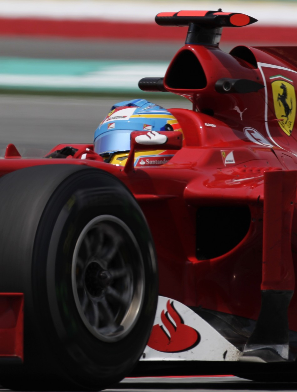 Ferrari Formula One driver Alonso drives during the first practice session of the Malaysian F1 Grand Prix at Sepang International Circuit outside Kuala Lumpur