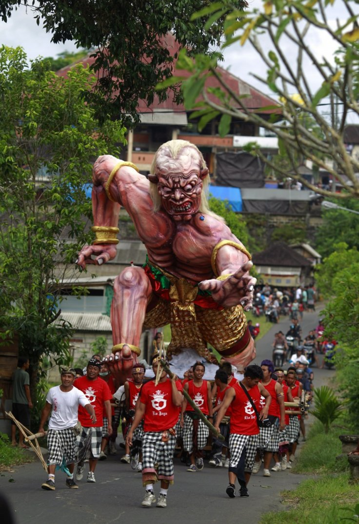 alinese carry an Ogoh-ogoh effigy during a ritual ahead of Nyepi day in Ubud Gianyar, Bali