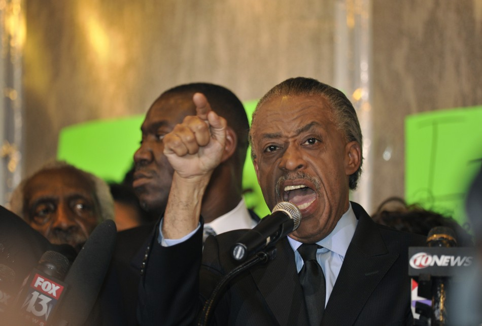 Rev Al Sharpton stood with Eric Garner's family and addressed protesters at the National Action Network's headquarters in Harlem.