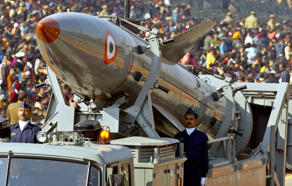 Indian soldiers stand beside India's surface-to-surface missile Agni 2 in New Delhi