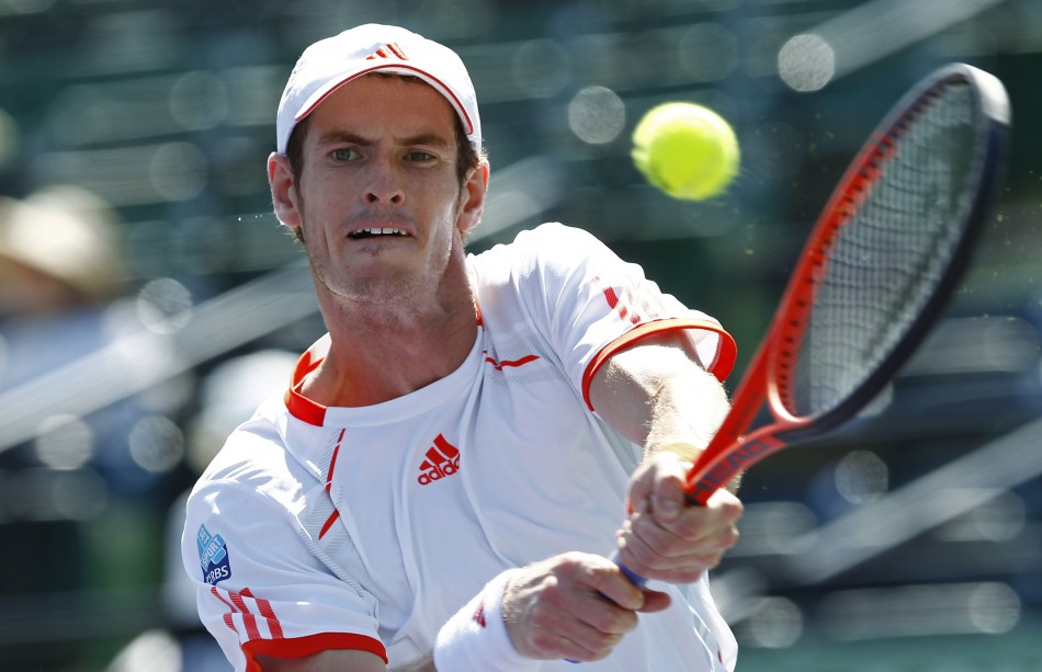Murray of Britain hits a return to Falla of Colombia at the Sony Ericsson Open tennis tournament in Key Biscayne