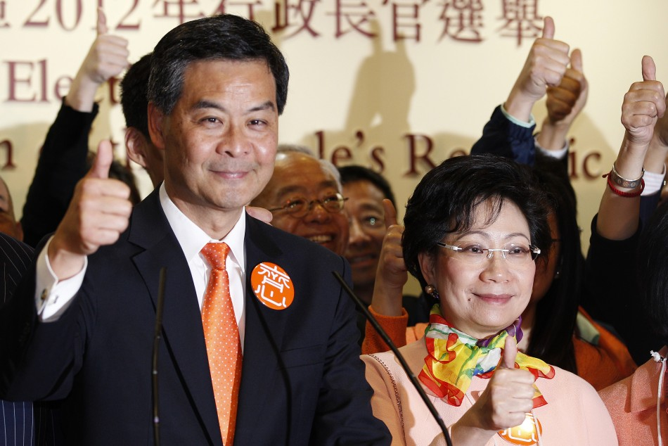 The next Hong Kong Chief Executive Leung celebrates with his wife Regina Tong in Hong Kong