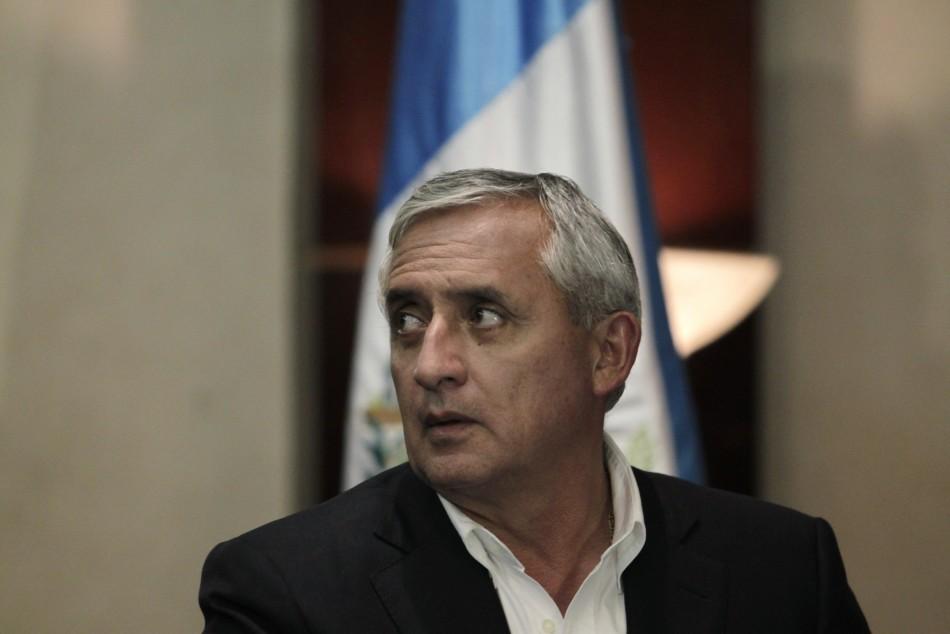 Guatemalan President Otto Perez Molina attends a news conference in the TSE in Guatemala City