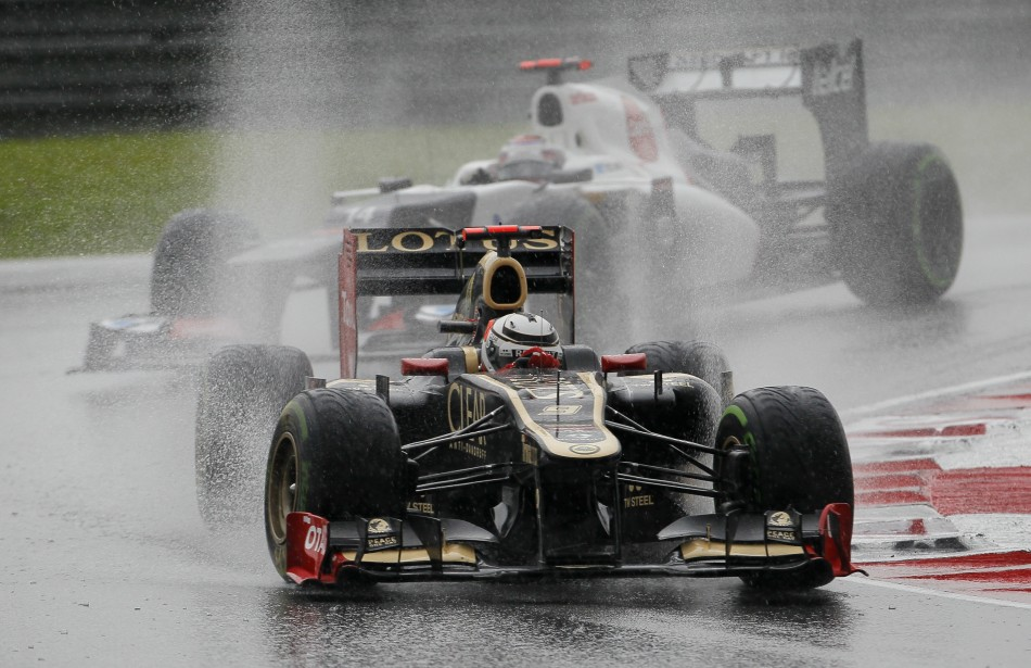 Lotus F1 Formula One driver Raikkonen leads Sauber Formula One driver Kobayashi during the Malaysian F1 Grand Prix at Sepang International Circuit outside Kuala Lumpur