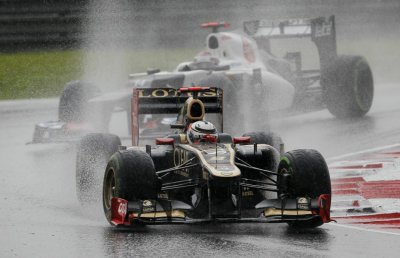 Lotus F1 Formula One driver Raikkonen leads Sauber Formula One driver Kobayashi during the Malaysian F1 Grand Prix at Sepang International Circuit outside Kuala Lumpur
