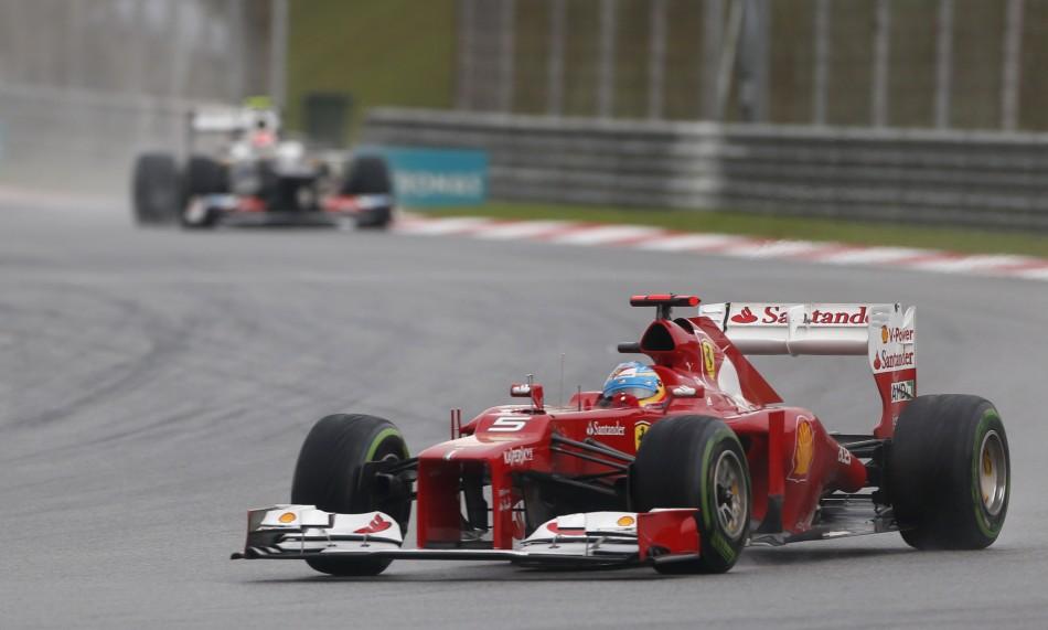 Ferrari Formula One driver Alonso leads Sauber Formula One driver Perez during the Malaysian F1 Grand Prix at Sepang International Circuit