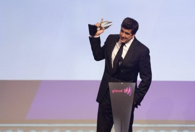 News anchor Elliott accepts an award for Outstanding Journalism TV at the 23rd annual GLAAD Media Awards in New York