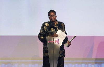 Carolyn Brown accepts an award for Outstanding Magazine Article at the 23rd annual GLAAD Media Awards in New York